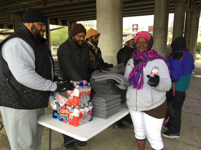 Austin Alphas assisting Austin Homeless with Blankets